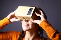 cardboard-virtual-reality-color-shot-young-woman-looking-device-which-one-can-experience-mobile-phone-51059437